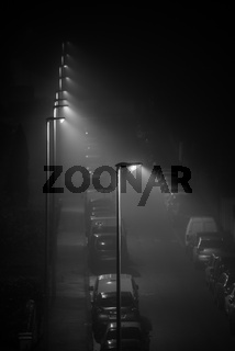 Street lights in foggy night