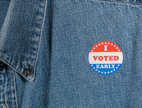 Blue denim working clothing with I Voted Early sticker