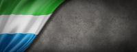 Sierra Leone flag on concrete wall banner