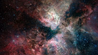 Nebula and glowing stars in deep space. Elements of this image furnished by NASA