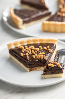 Sweet chocolate pie with crushed nuts.