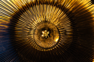 Inside of a filament lamp holder - Abstract electricity background concept