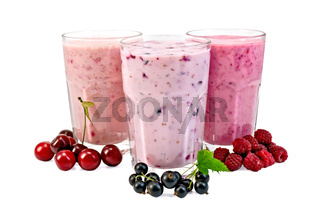 Milk shakes with berries in glass