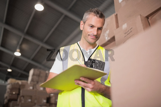 Warehouse worker with clipboard