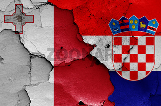 flags of Malta and Croatia painted on cracked wall