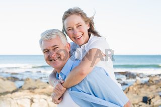 Casual couple having fun by the sea