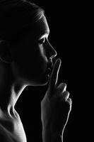 female silence gesture