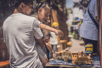 Father and daughter buying souvenirs in Fenghuang