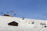 Snowy ski track prepared with snow grooming machine