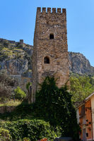 Famous historic buildings castle tower view against blue sky located on hill above the town of Xativa, Valencia, Spain