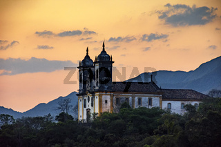 Ancient and historic church on top of the hill during sunset