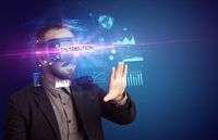 Businessman looking through Virtual Reality glasses