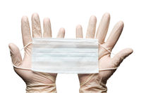 Human hands holding surgery medical face mask in white gloves isolated on white background. Medicinal concept during pandemic and coronavirus