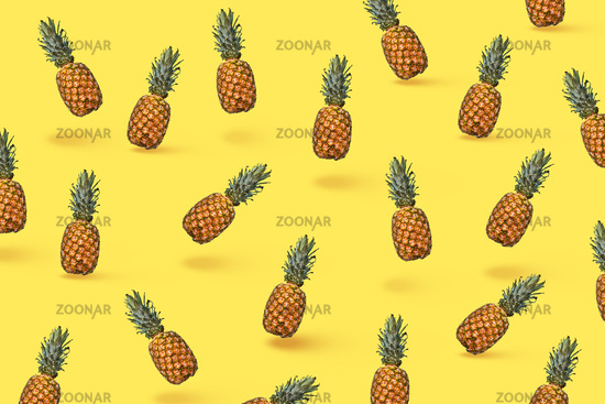 Food composition of ripe pineapple and halved fruit on a blue background with space for text. Flat lay
