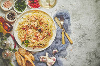 Seafood concept. Pasta with shrimps in a plate, close-up, copy space, top view, flat lay.