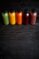 Colorful bottles filled with fresh fruit and vegetable juice or smoothie