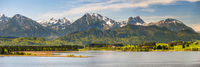 panoramic landscape in Bavaria with mountain range and lake