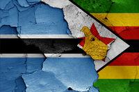 flags of Botswana and Zimbabwe painted on cracked wall