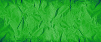 Green crumpled paper texture. Banner background