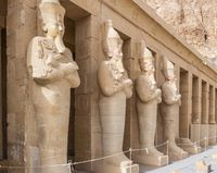 Osiride statues stand in front of the columns at the Mortuary Temple of Hatshepsut