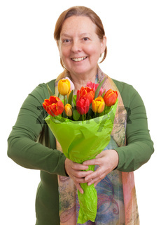 Elderly woman holding a bouquet of colorful tulips, isolated on white background. Mothers day, Valentines day, Easter and surprise Concept.