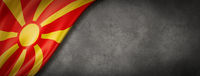 Macedonian flag on concrete wall banner
