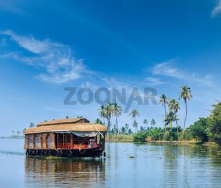 Travel tourism Kerala background - houseboat on Kerala backwaters. Kerala