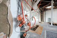 new electric installation cables and sockets in flat room during renovation   -