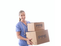Nurse or healthcare worker holding boxes of PPE or medical equipment