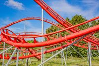 Red roller coaster against the sky