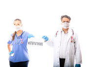 Two medical staff hold a sign during Coronavirus COVID-19 pandemic outbread