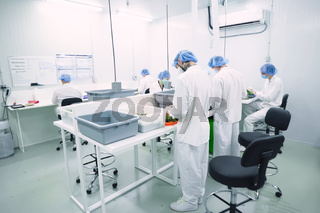 Laboratory for quality control of grown cannabis for medical purposes. Picking marijuana.