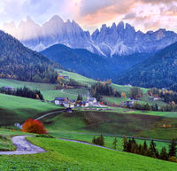 Autumn daybreak Santa Magdalena famous Italy Dolomites village view in front of the Geisler or Odle Dolomites mountain rocks.