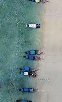 Thailand long tail and speed boat thai at Phuket beach, beautiful crystal emerald green water