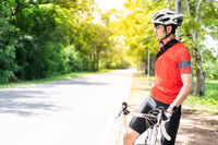 Asian man cyclist portrait with bicycle.