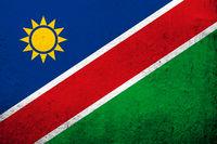 The Republic of Namibia National flag. Grunge background