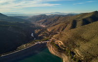 Aerial photography Embalse de Canales Reservoir in Guejar Sierra, province of Granada, Andalusia, Spain. Picturesque nature green hills and turquoise clear water view from above. Spain