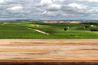 Retro wooden table on a natural countryside background for display or montage your products.