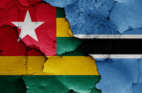 flags of Togo and Botswana painted on cracked wall