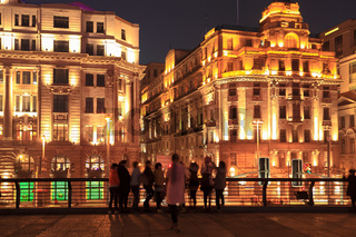 shanghai bund at night with tourists