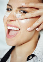 Happy woman with powder under eyes