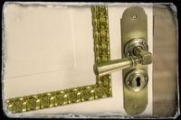 Brass vintage handle on white door