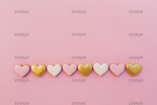 Pink background with sweet gingerbread heart cookies