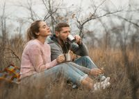 Happy Couple Drink Coffee Looking On Sunset Outdoors