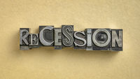recession word in gritty vintage letterpress metal types