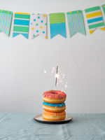 Birthday donuts cake with sparkler on table