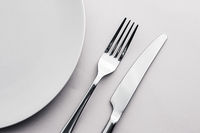 Empty plate and cutlery as mockup set on white background, top tableware for chef table decor and menu branding