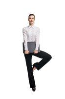Female entrepreneur with laptop balancing on leg