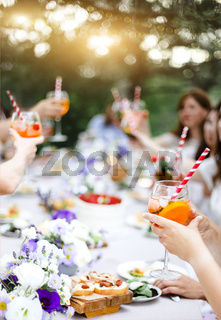 Crop people with cocktails during banquet