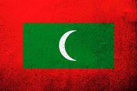 The Republic of Maldives National flag. Grunge background